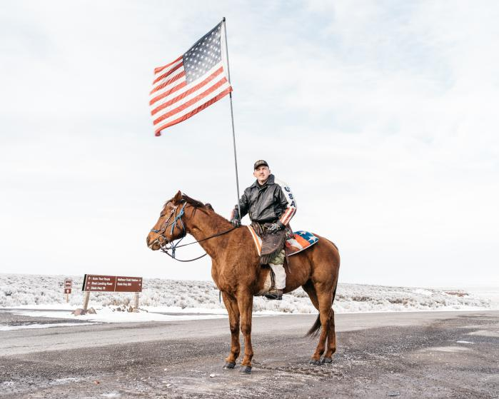 Dwayne Ehmer, of Irrigon Oregon, atop his horse Hellboy greet the press on 1/12 before the press conference at the entrance to the Malheur National Wildlife Refuge, Harney County, Oregon, 1/12/16